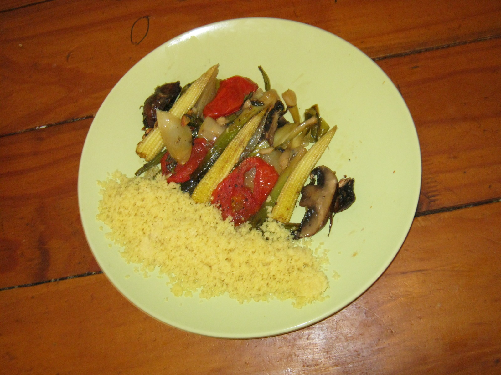 Baked baby leeks with couscous and mixed veggie combo