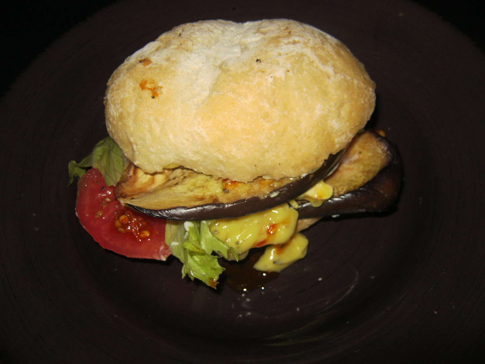 Brinjal Burger with tomato lettuce and avocado