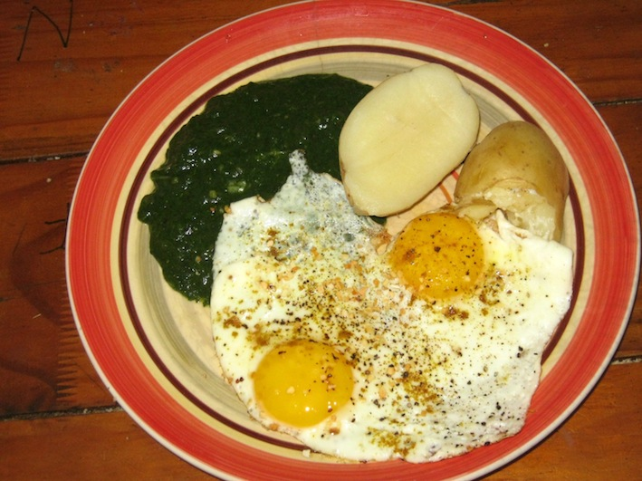 Potatoes with fried eggs and chard