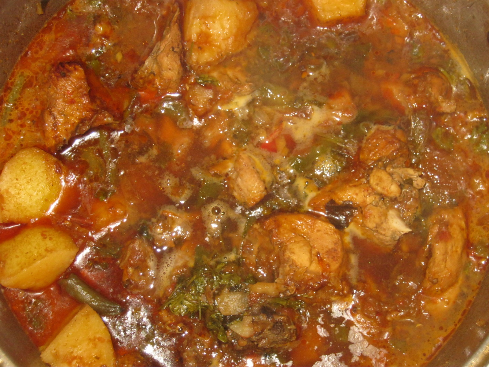 Traditional Durban Chicken Curry cooking in a pot