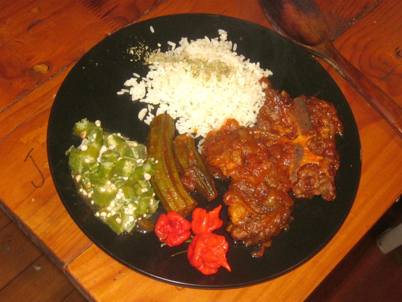 Ghanaian Beef stew with steamed rice and boiled okra