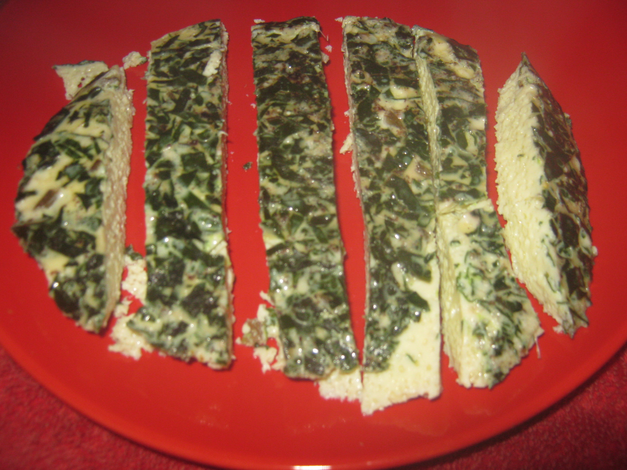 Green Eierstich slices on a red plate