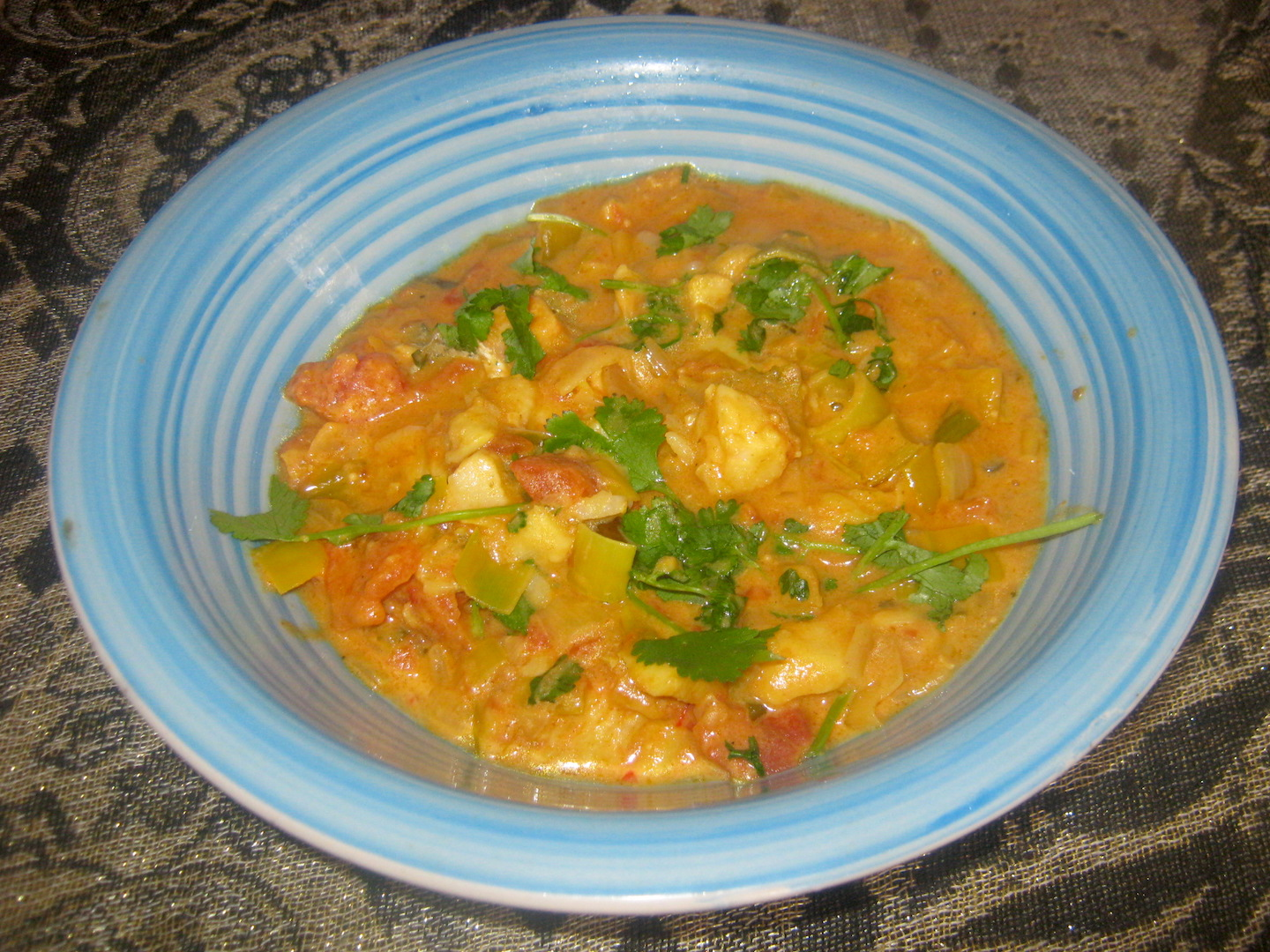 Kerala Fish Curry in a blue bowl