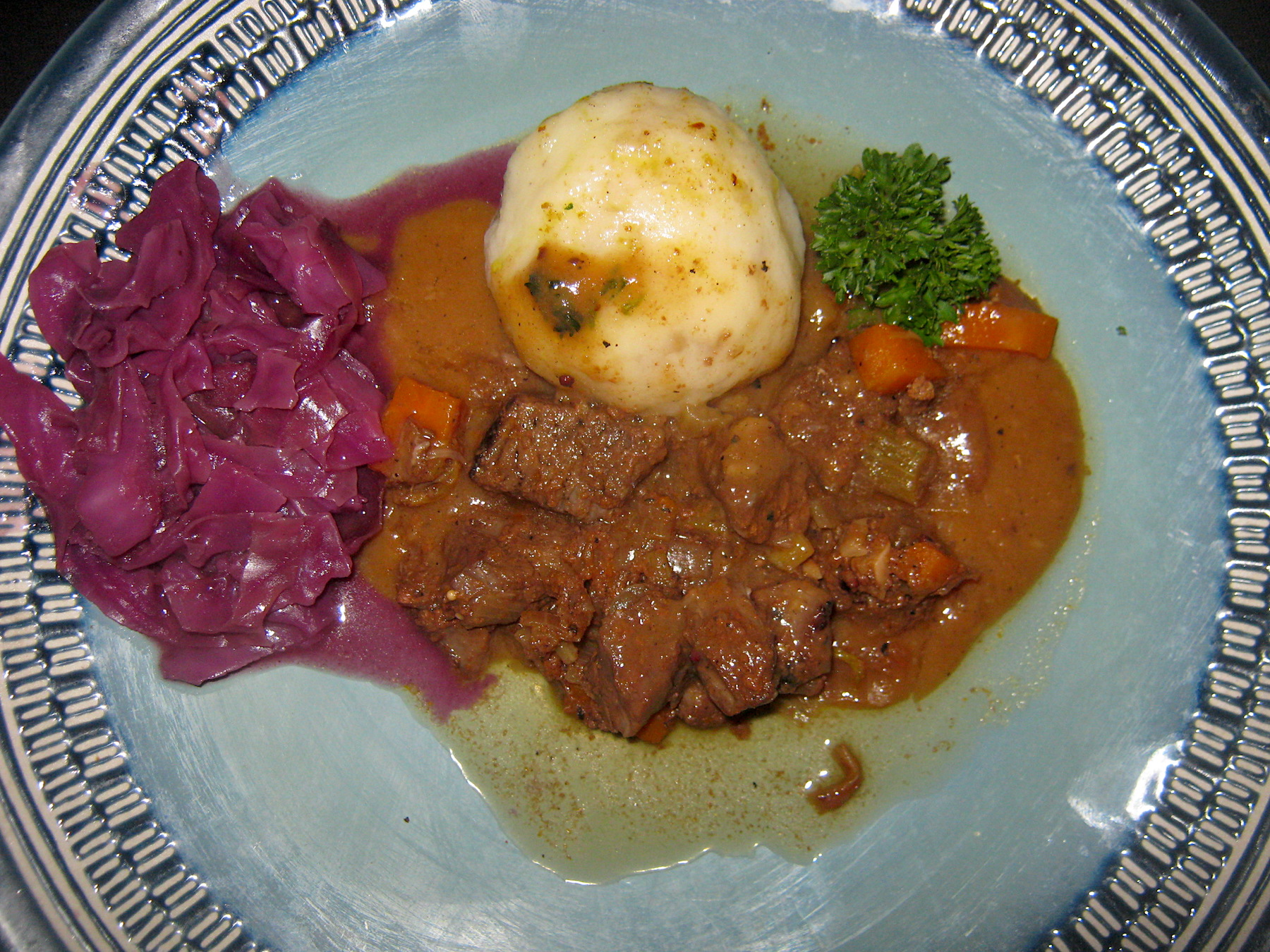 German style Sour marinated beef with potato dumpling, gravy and red cabbage