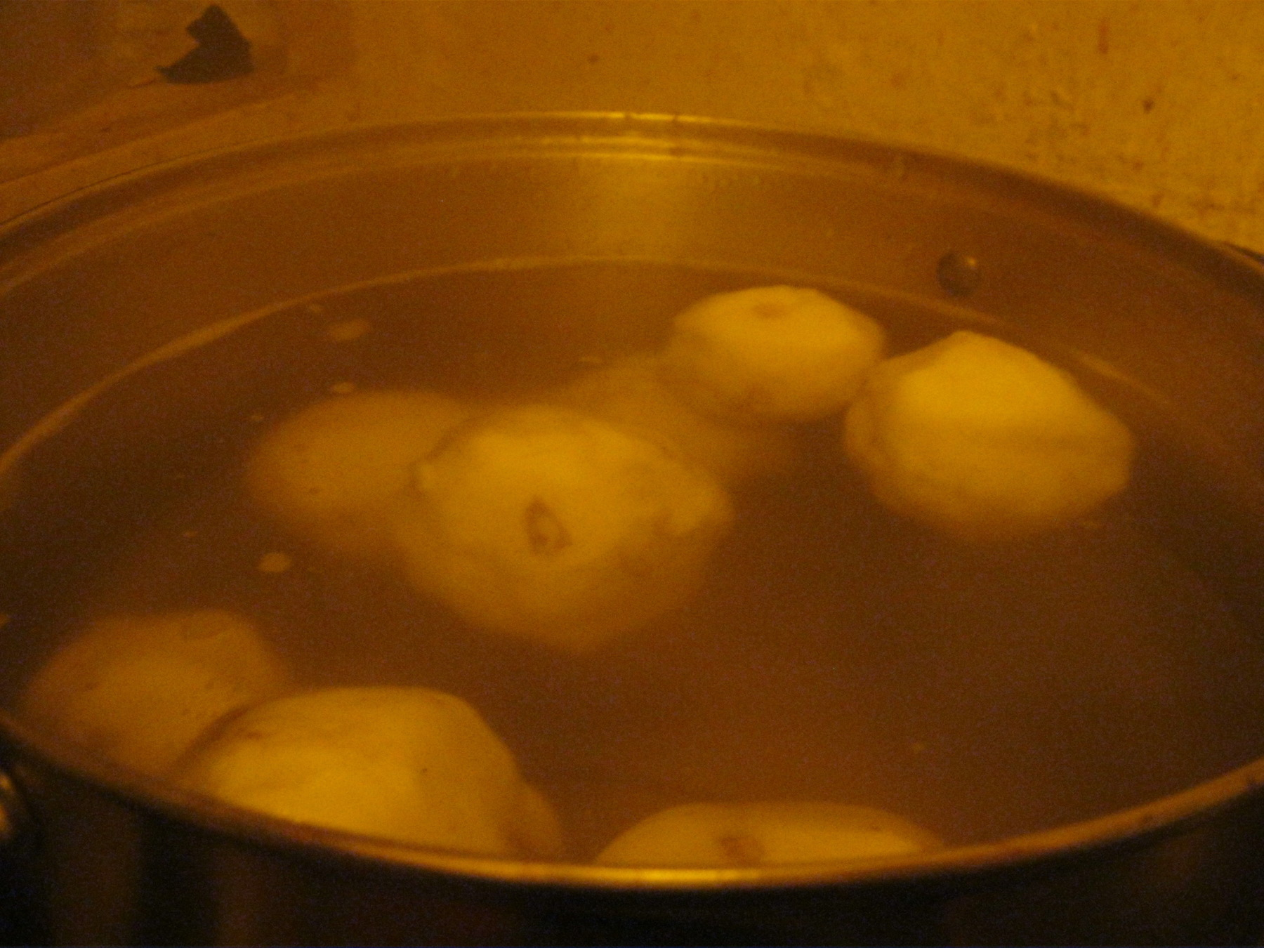 Most of the dumplings in this pot have already risen to the surface indicating that they are done.