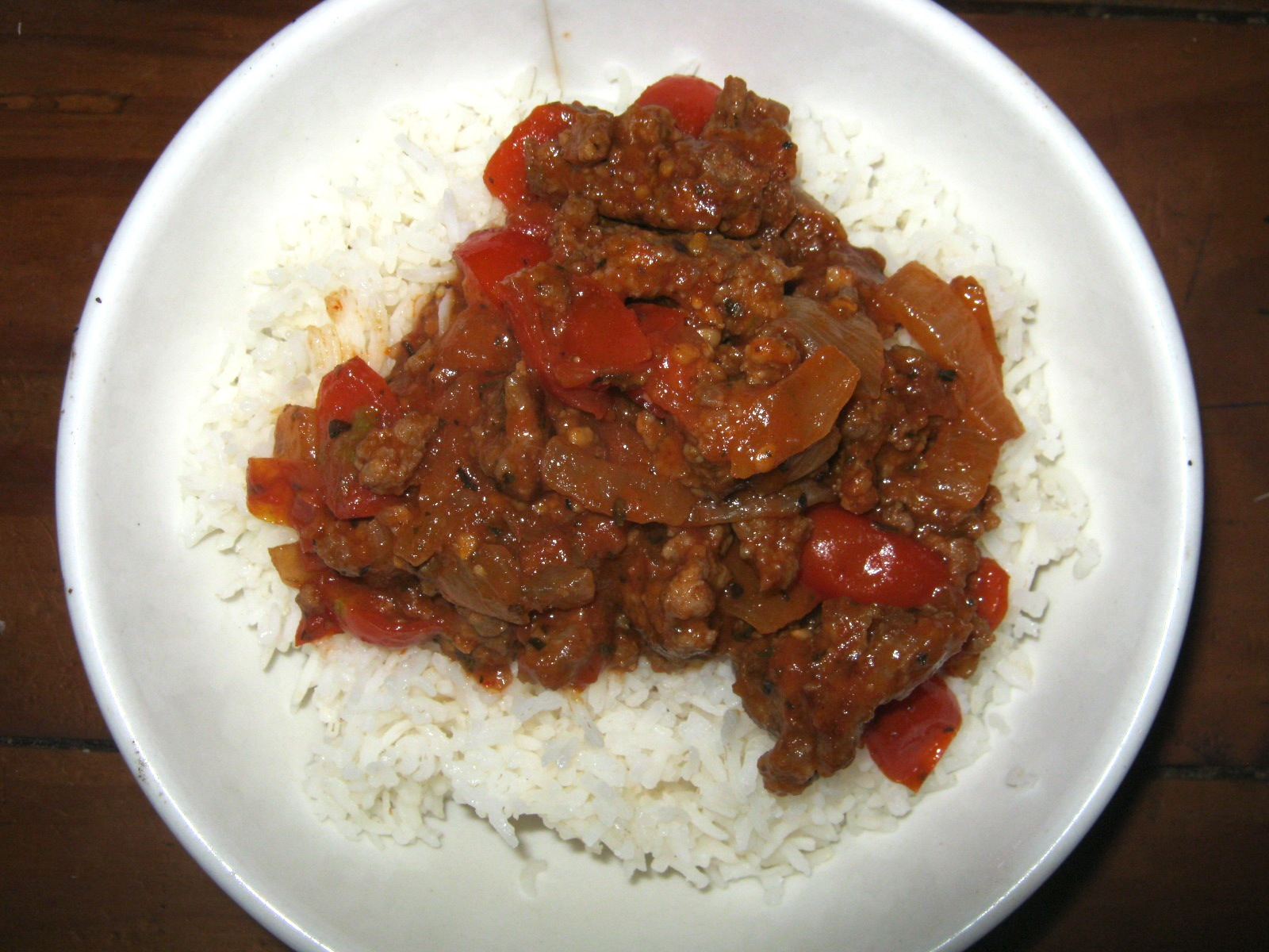 Tasty tomato sauce with mince served on a bed of rice