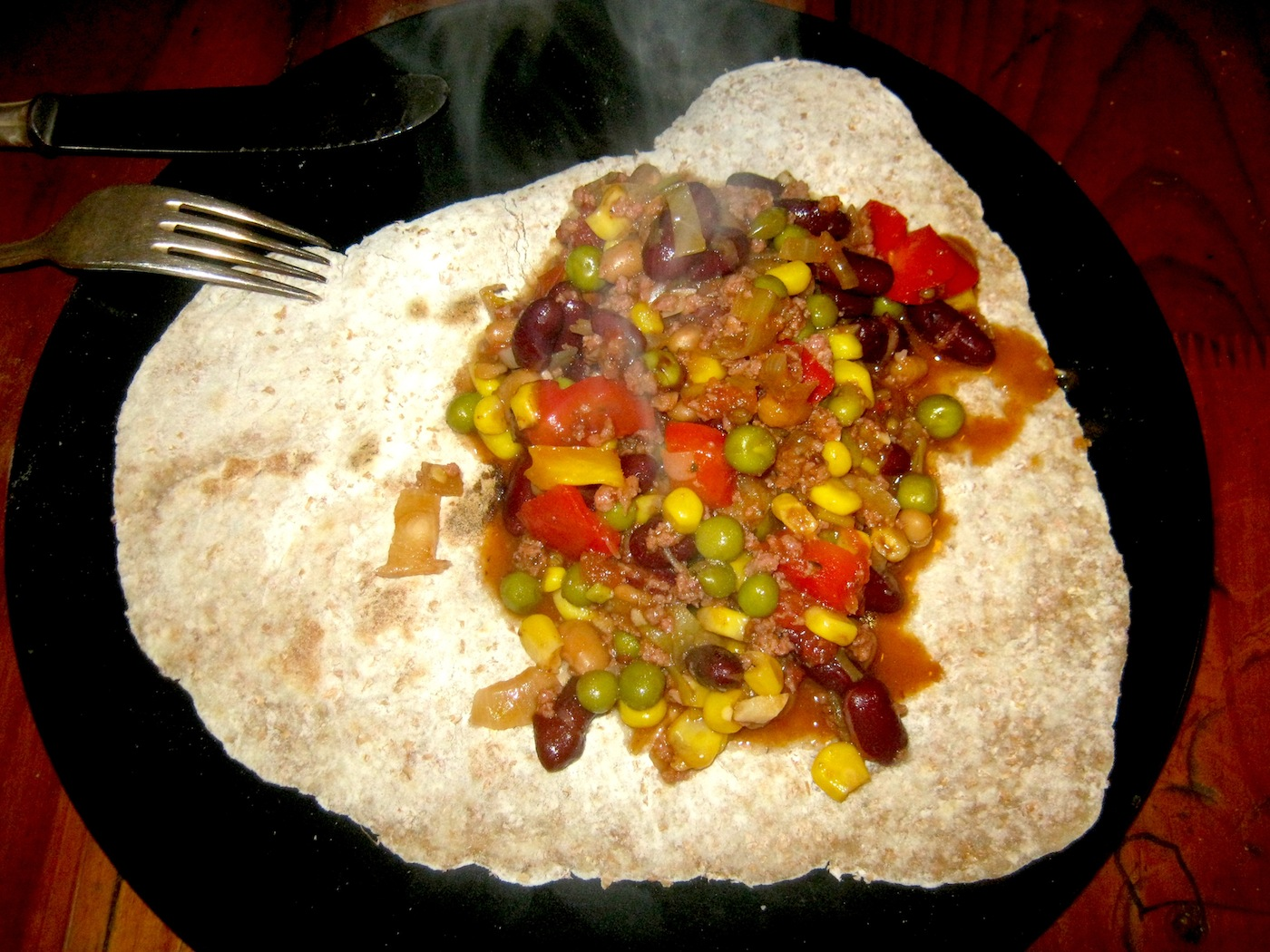 Chili con carne served on a tortilla