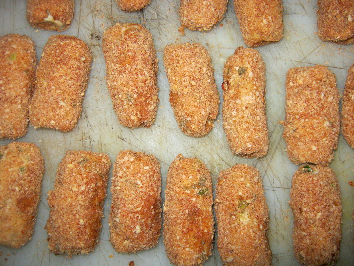 Raw dutch croquettes covered with bread crumbs