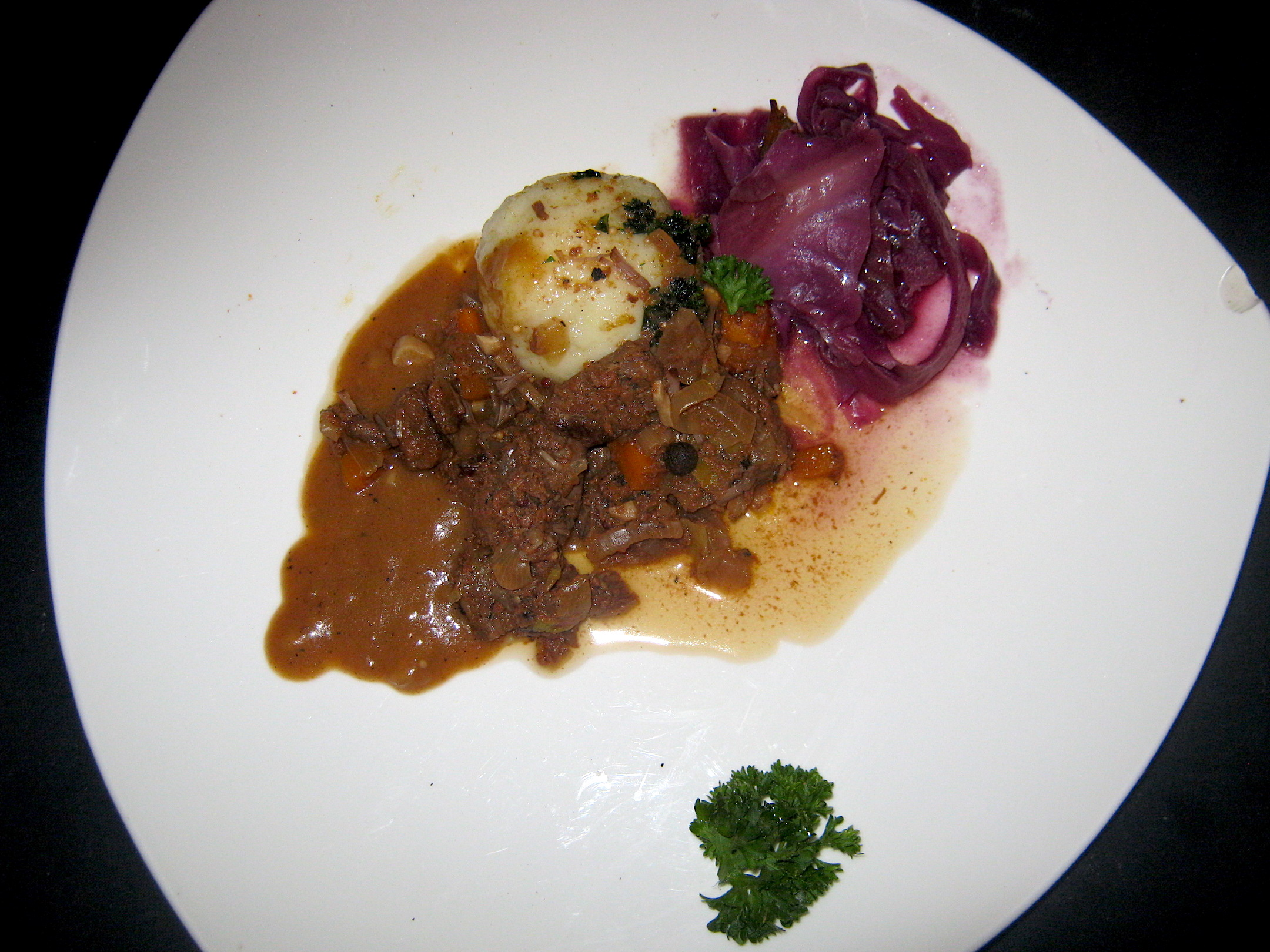 Marinated beef with potato dumpling and red cabbage