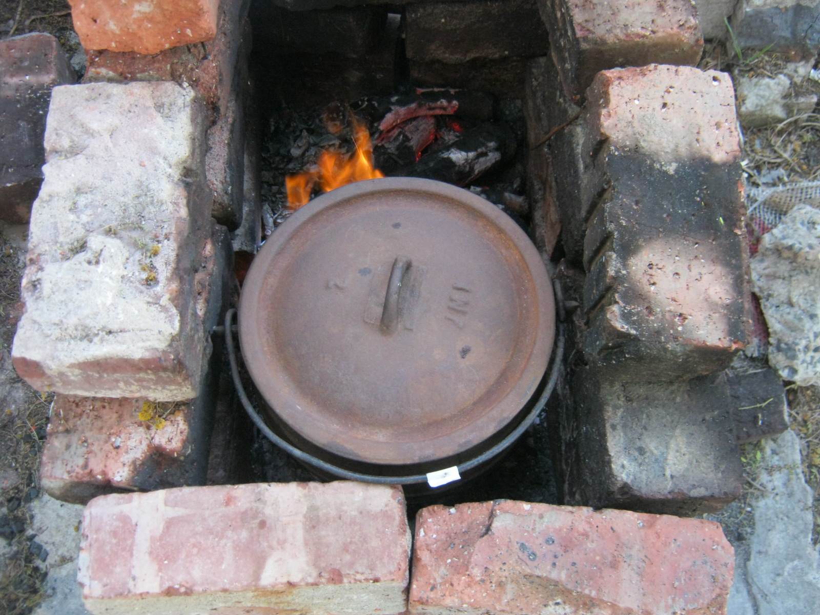 Place potjie on a few coals