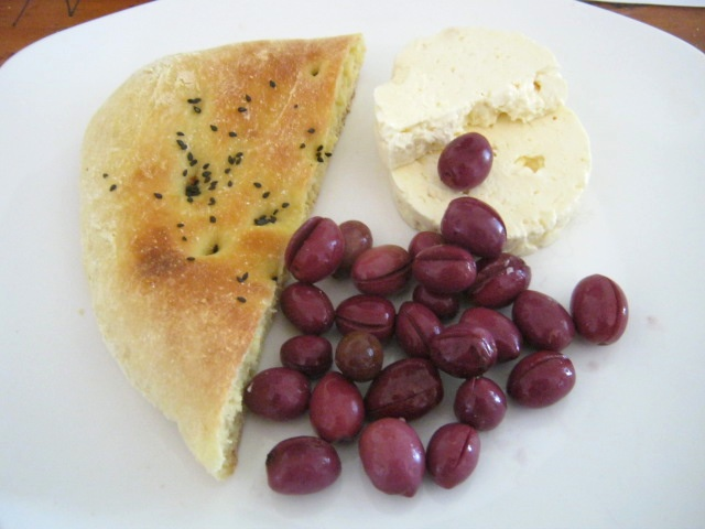 Traditional Hebrew breakfast with Olives, bread and feta cheese