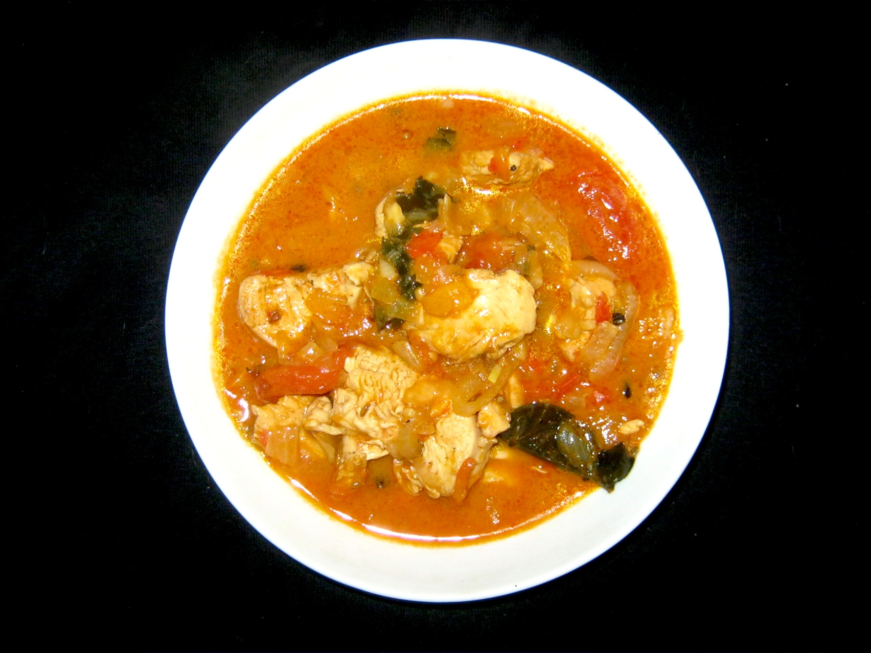 Madras Chicken Curry served in a white bowl