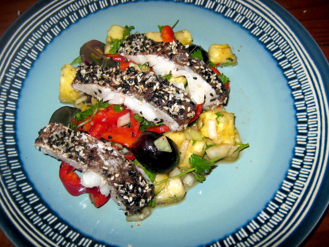 Hake in cinnamon sesame crust on pineapple chilli grape salad