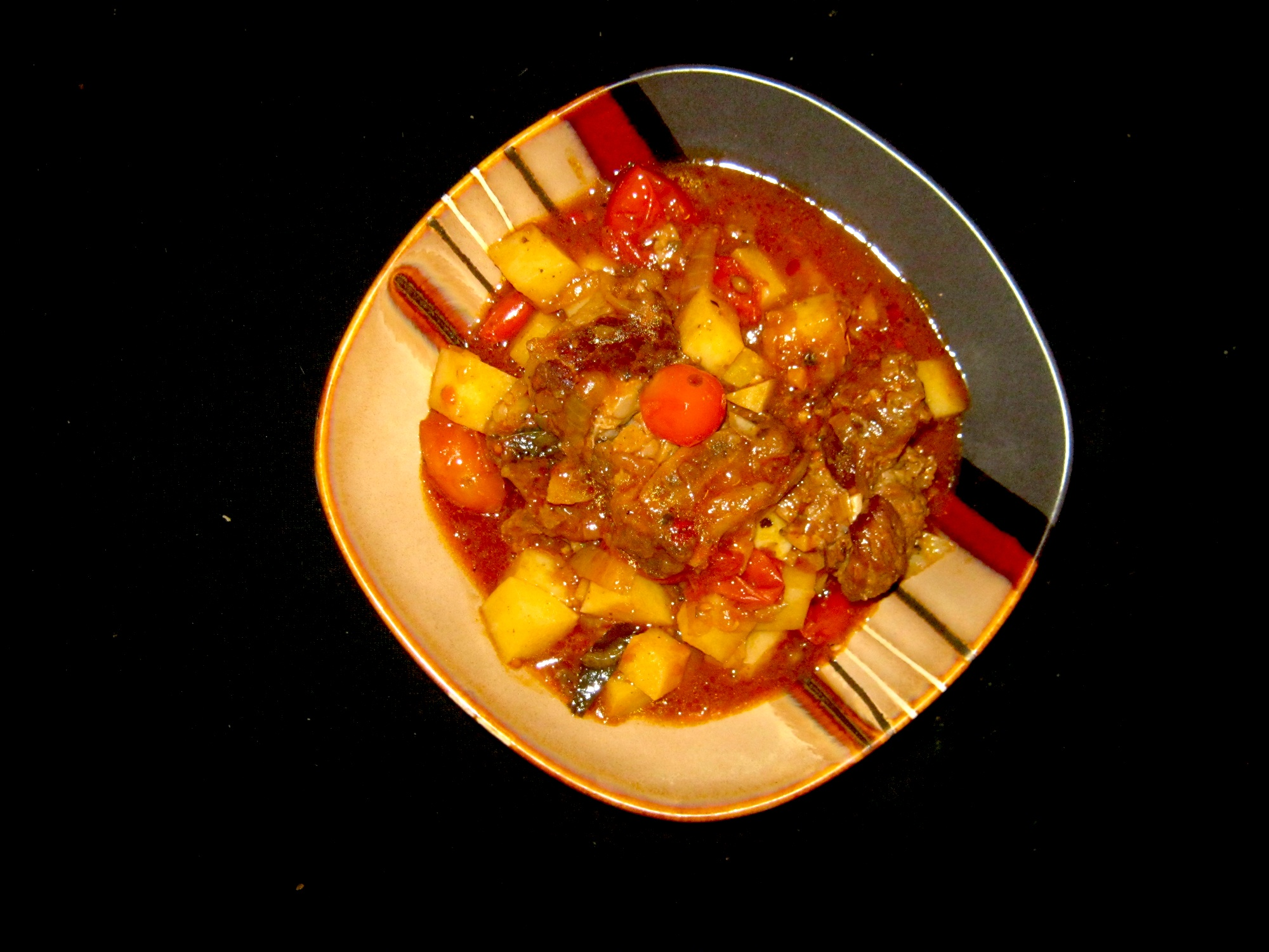 Potato bredie with stewing beef,peeled cherry tomatoes and fragrant spices.