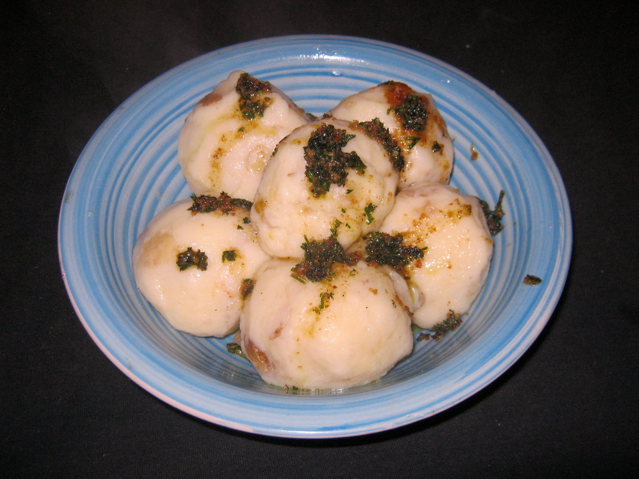 Potato dumplings with roasted parsley butter
