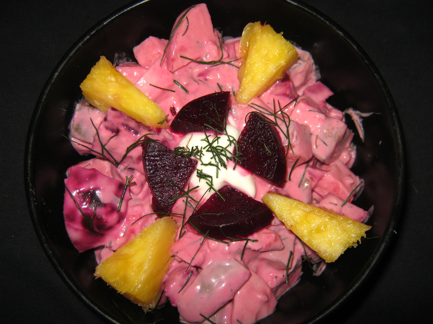 Red Herring Salad garnished with dill, pineapple and beetroot