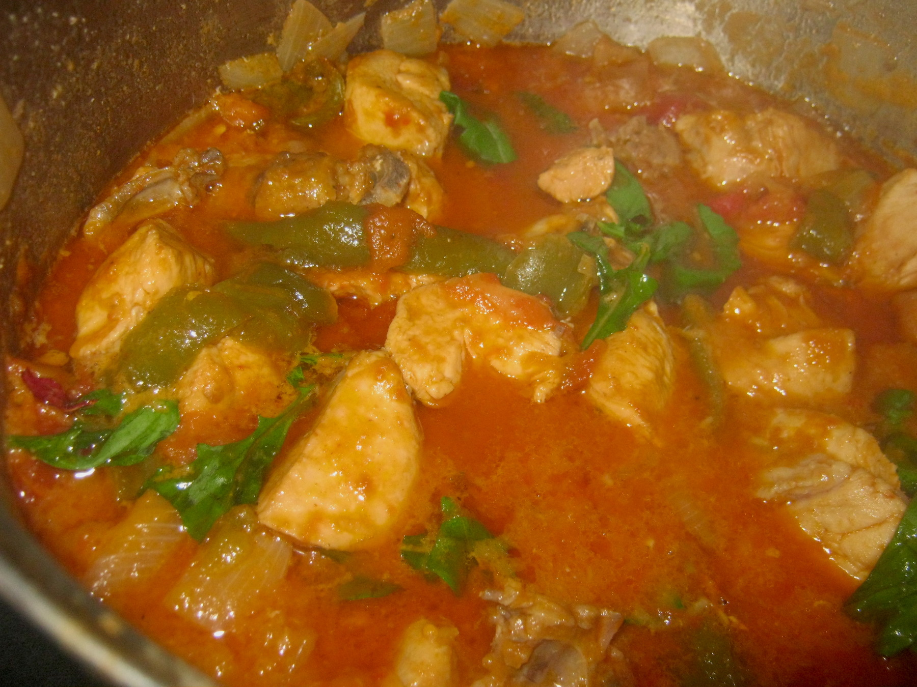 Chicken stew with sweet peppers in tomato gravy