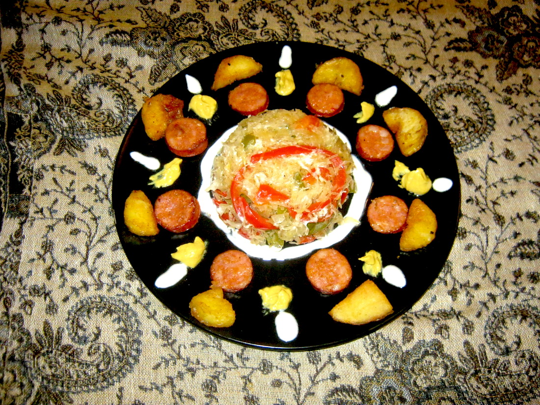 Sauerkraut, sweet peppers, fried potato wedges and smoked sausage with yoghurt and mustard sauce