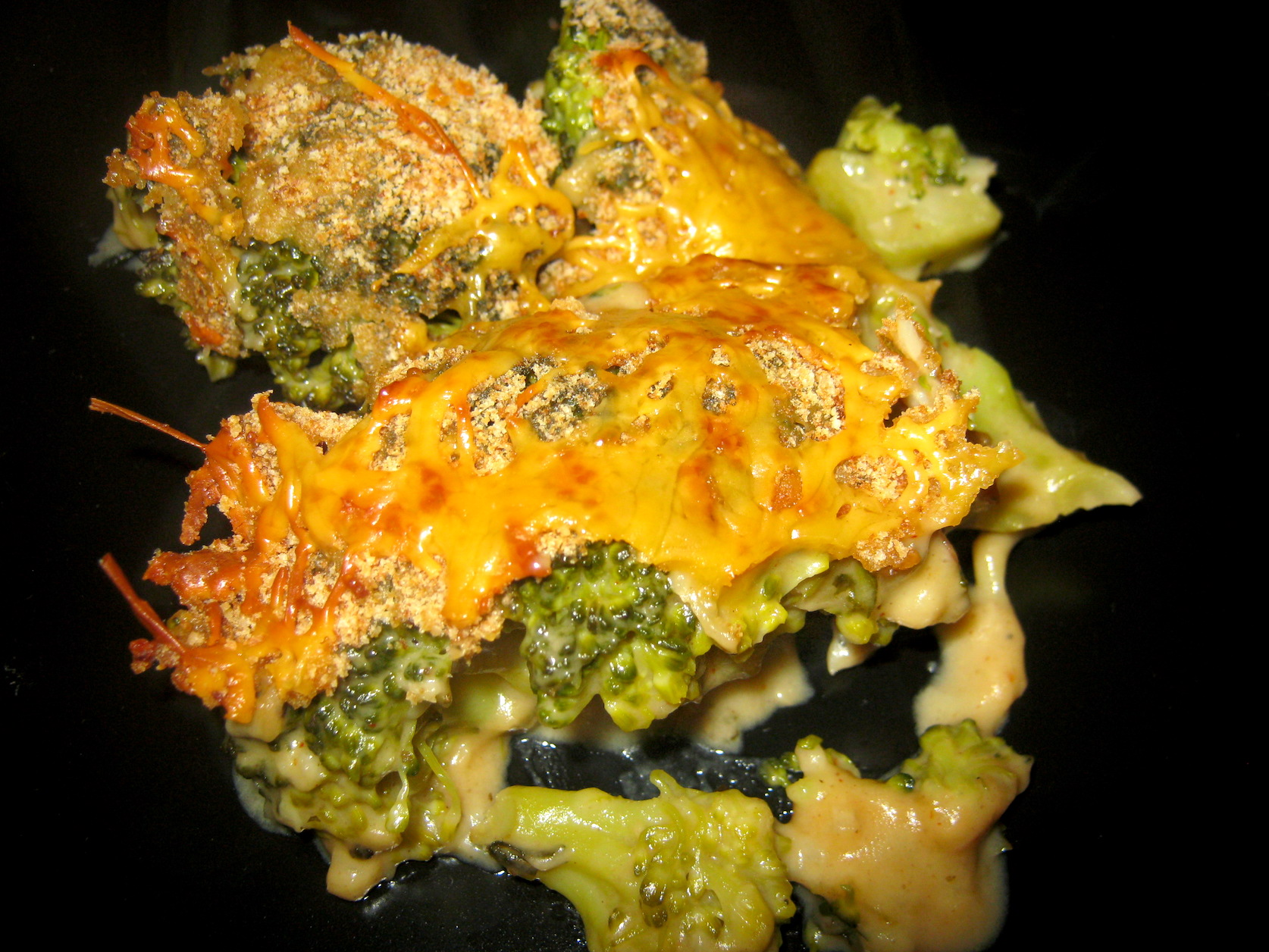Baked broccoli on a black plate