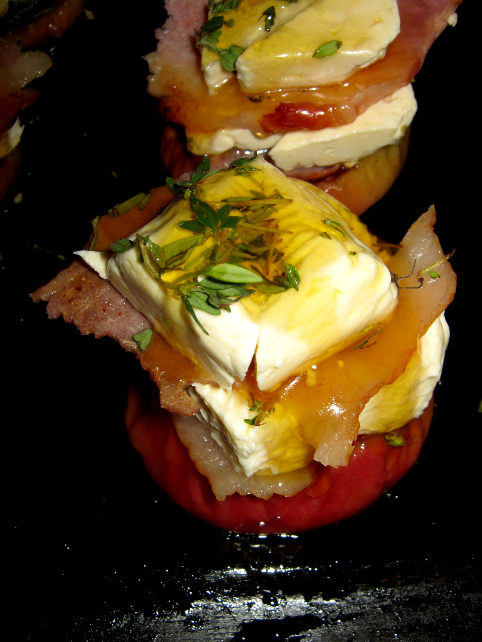 Raw apple, bacon and feta towers on a tray ready for baking