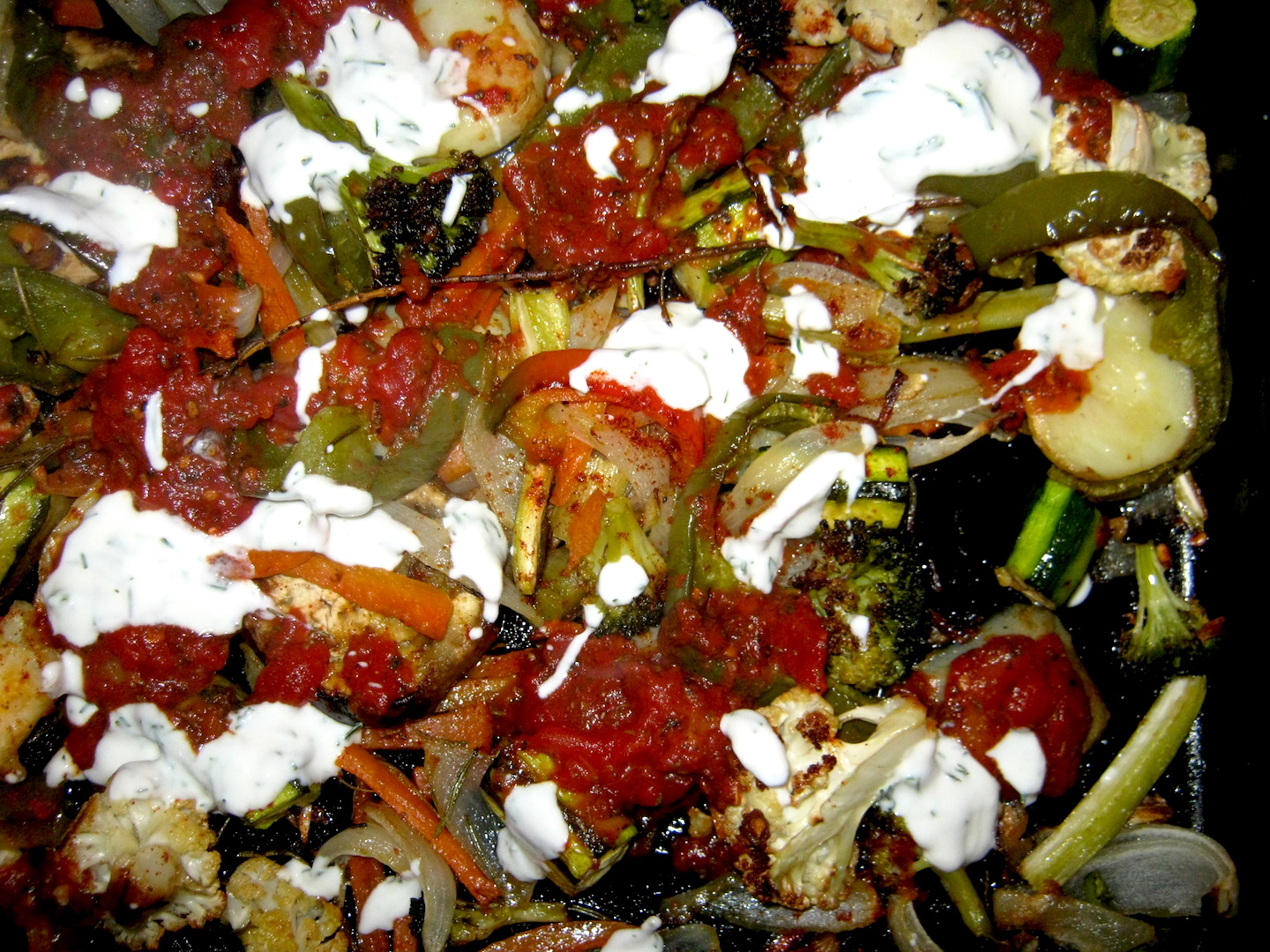 Baked mediterranean vegetables with yoghurt dip and spiced cooked tomato sauce