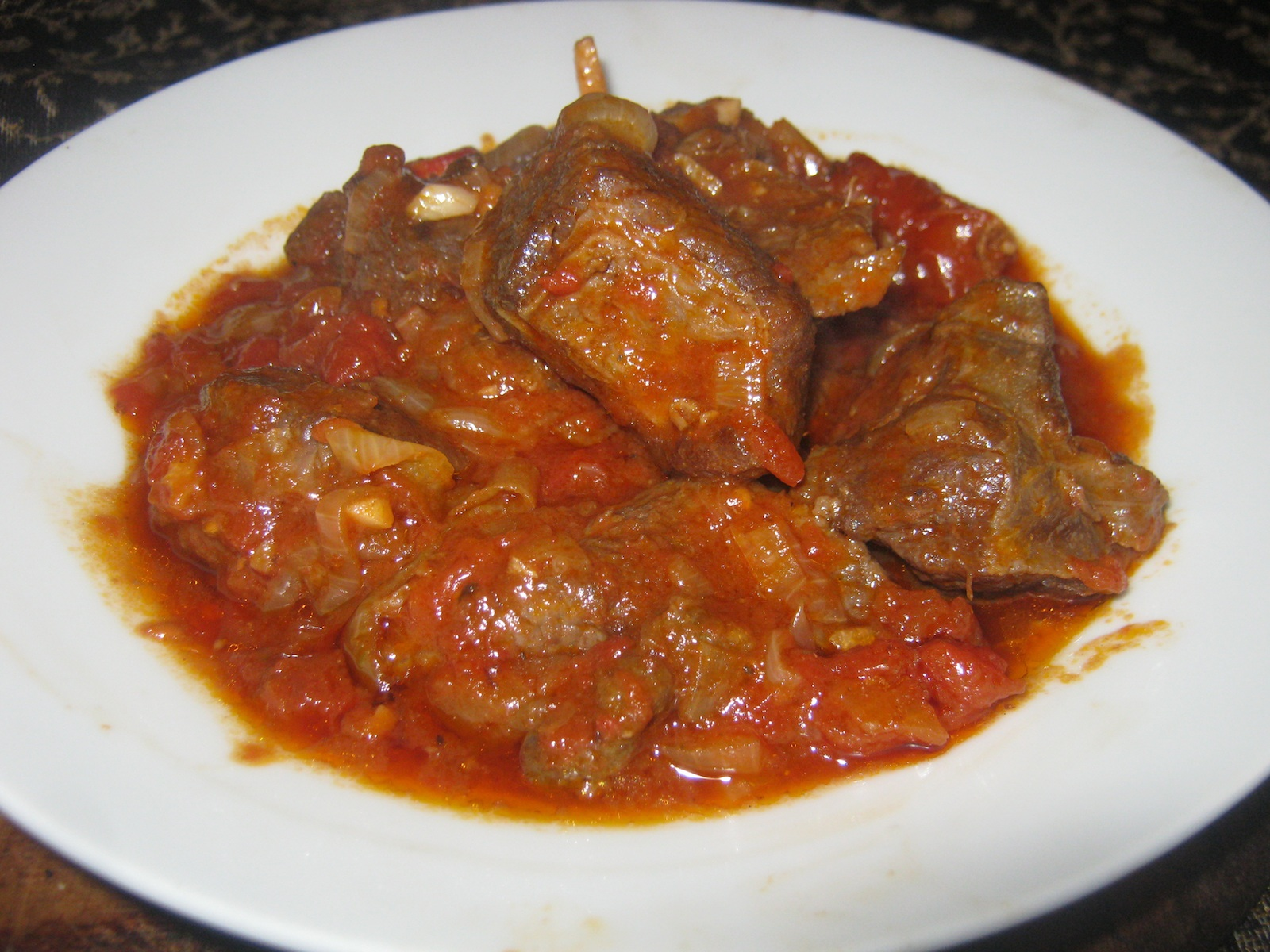 Blessbok Stew spiced with Carolina Reaper chili served on a white plate