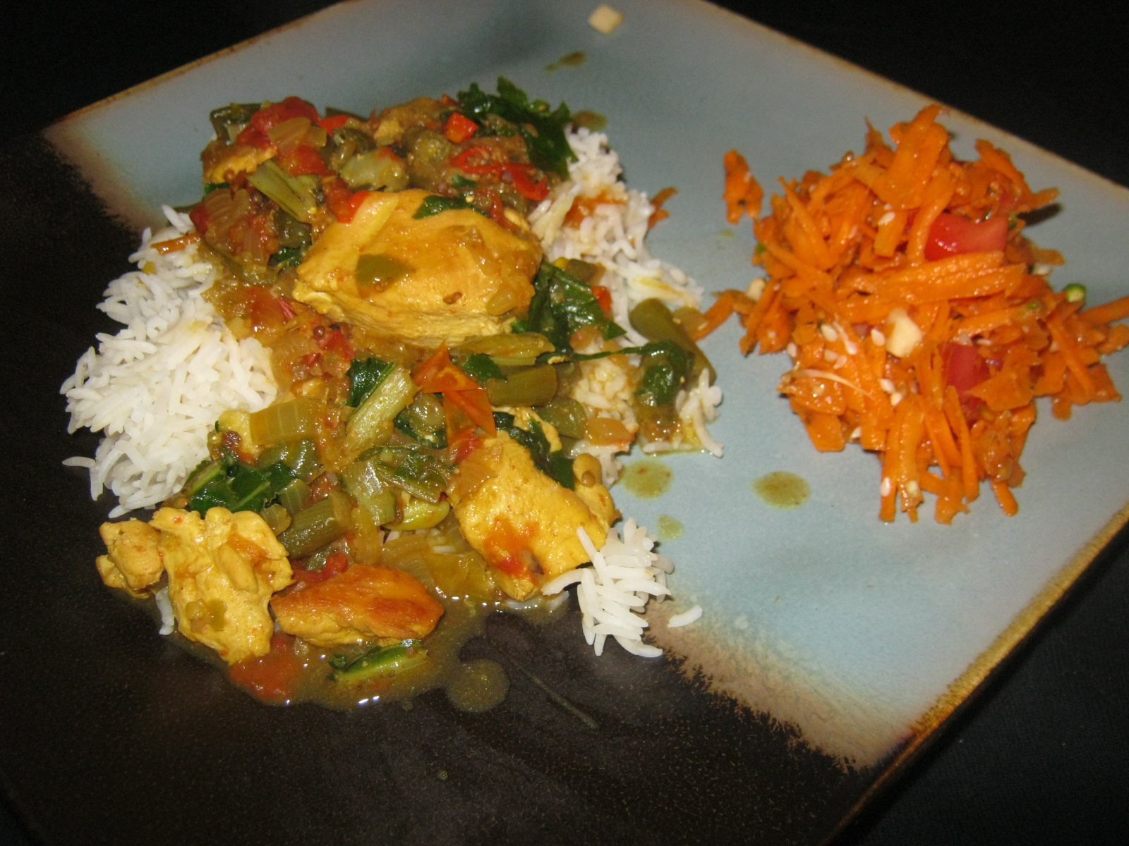 Bombay chicken curry on a bed of basmati rice and carrot tomato sambal