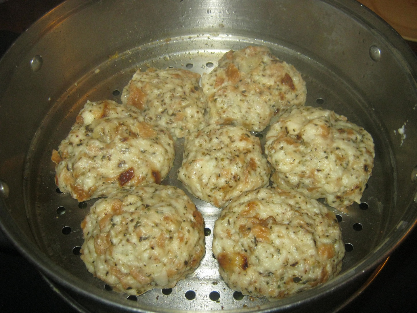 Bread dumplings in a steaming tray.