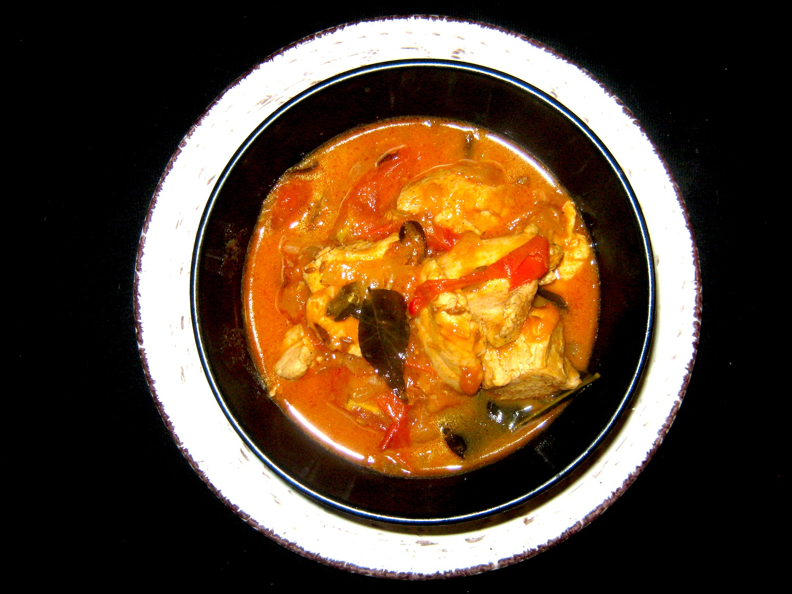 Chicken Madras served in a black bowl