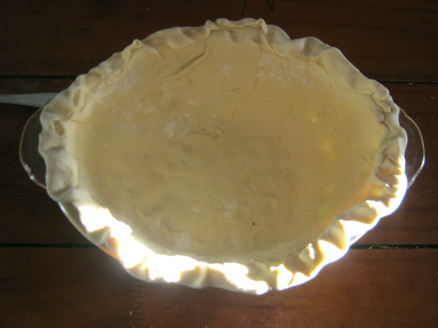 Raw chicken pot pie dough in a casserole dish