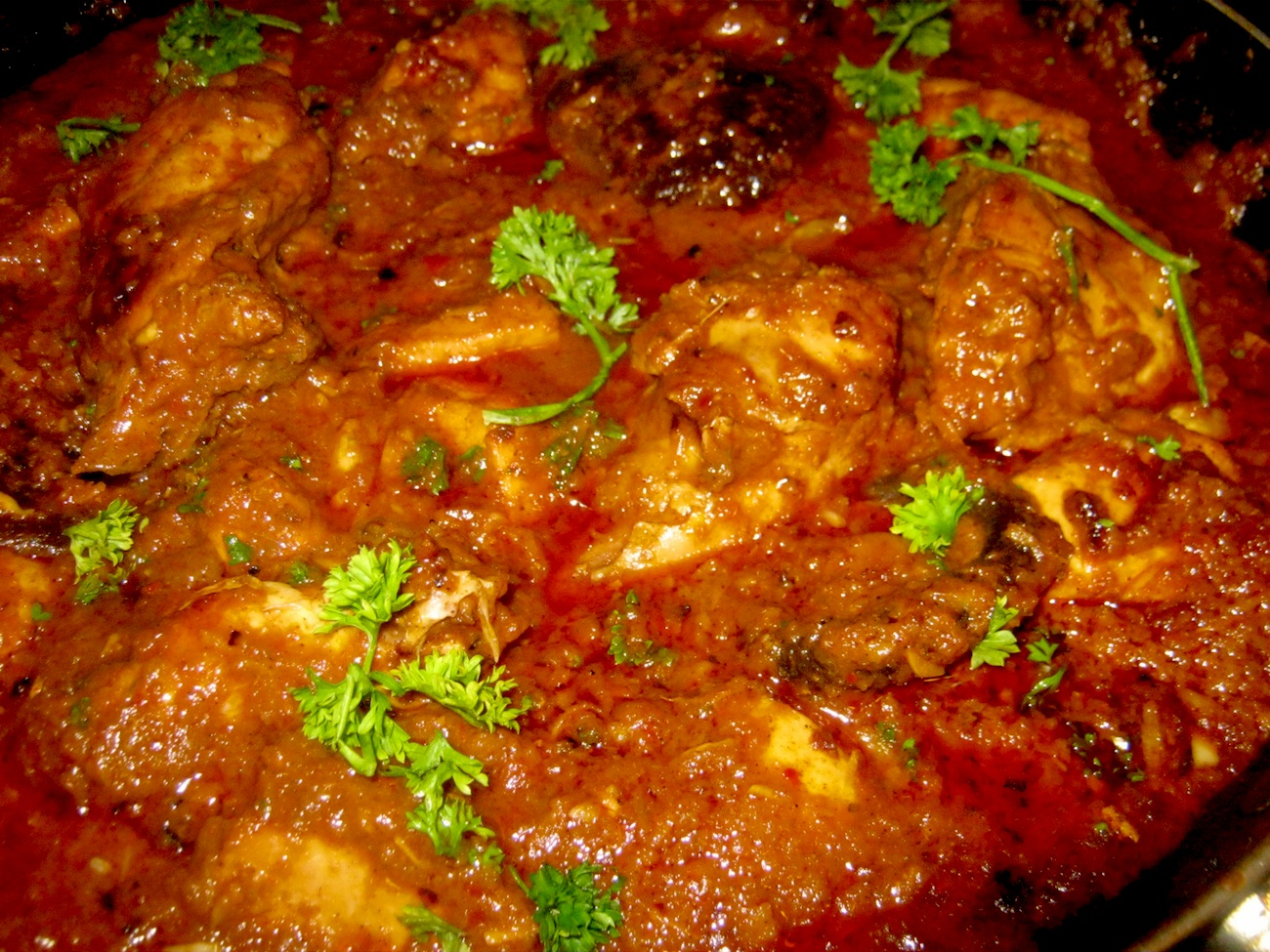 Chicken Rogan Josh in a skillet - close up