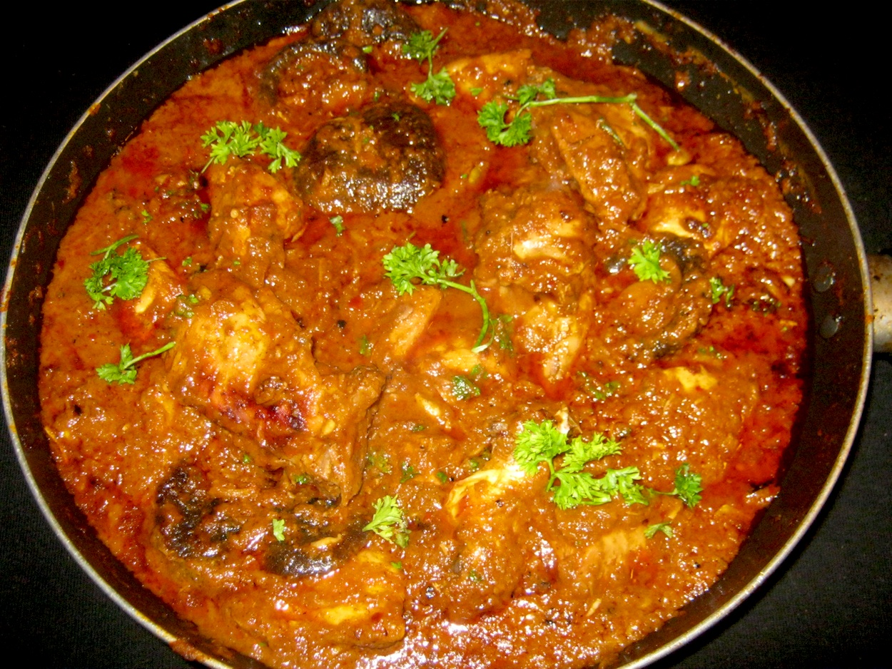 Chicken Rogan Josh in a skillet.