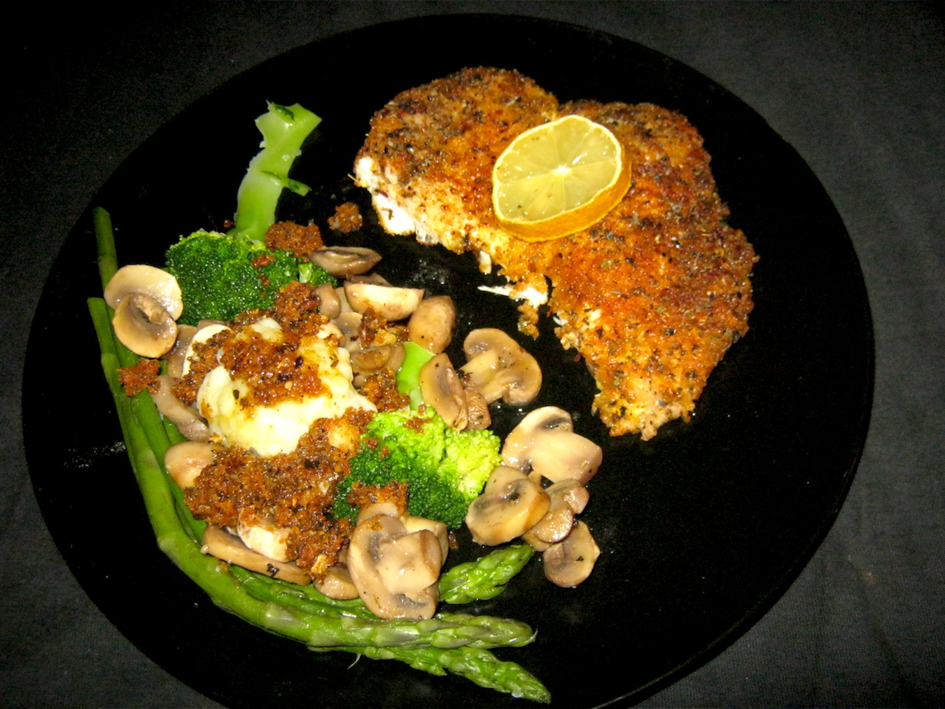 Chicken Schnitzel with green asparagus, button mushrooms, broccoli, cauliflower and buttered breadcrumbs