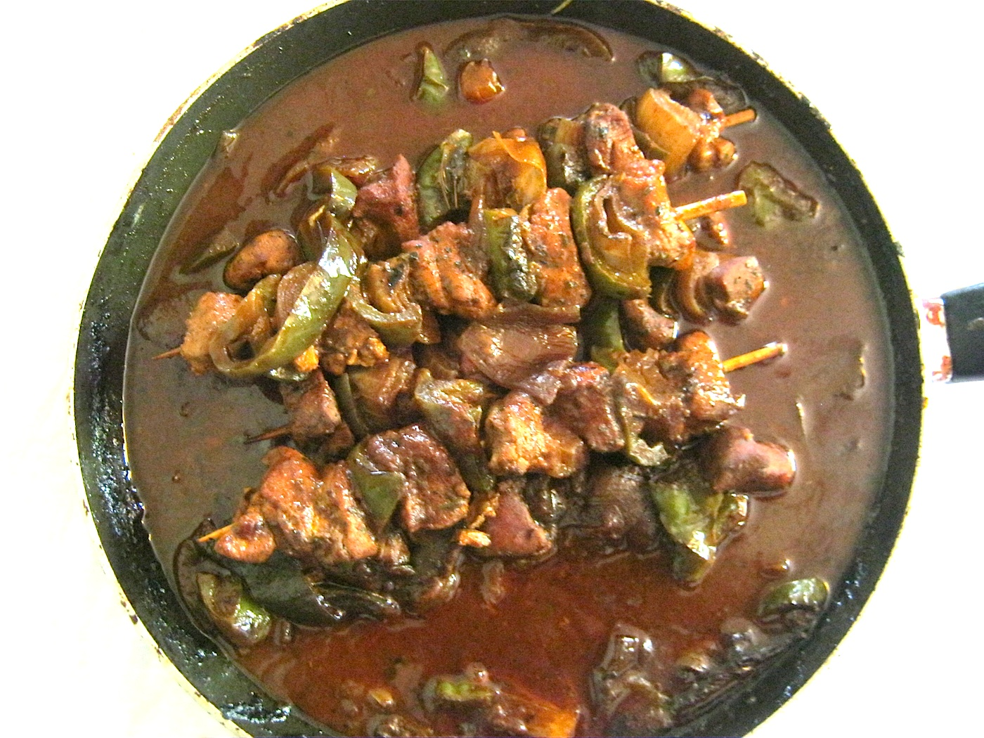 Shashlik with sauce in a pan