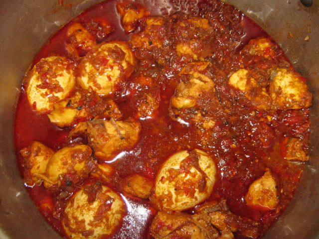 Doro wat - Traditional Ethiopian chicken stew with hardboiled eggs in hot pepper sauce