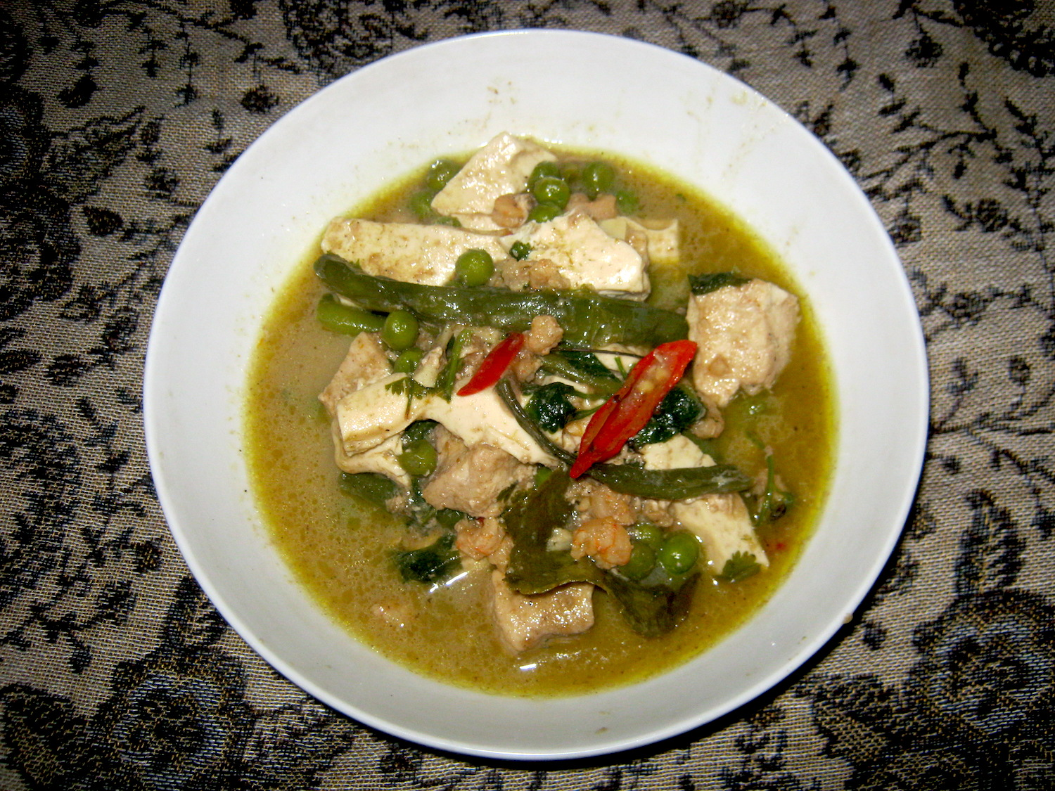 Thai Green Swordfish Curry in a white bowl