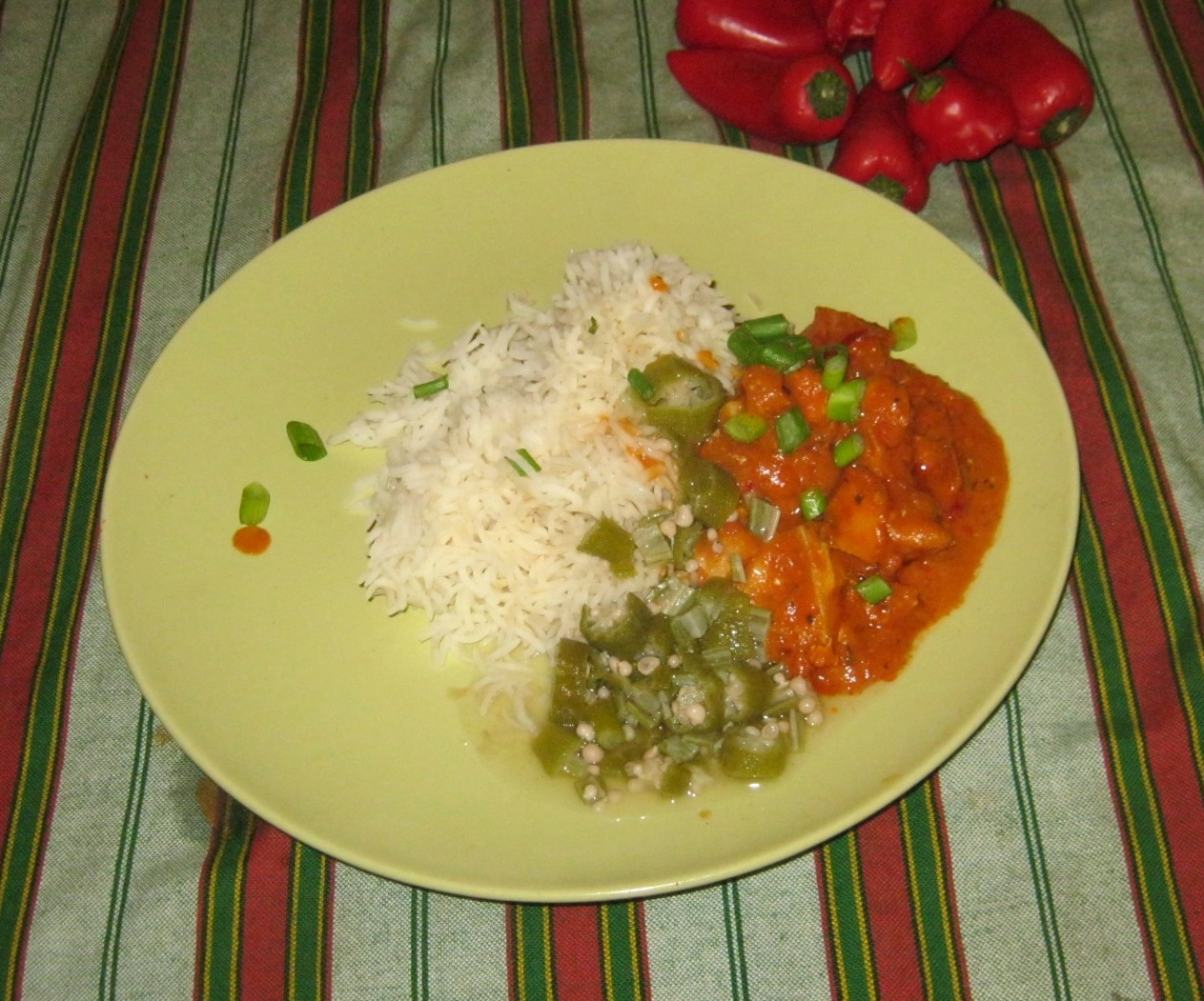 Hot Ghanaian Chicken Stew with Rice and cooked Okra