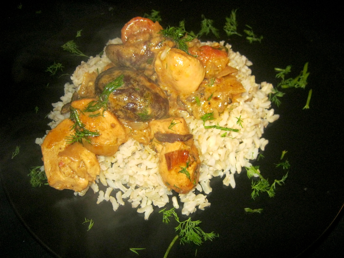 Indian Chicken Curry with Shiitake Mushrooms on a black plate