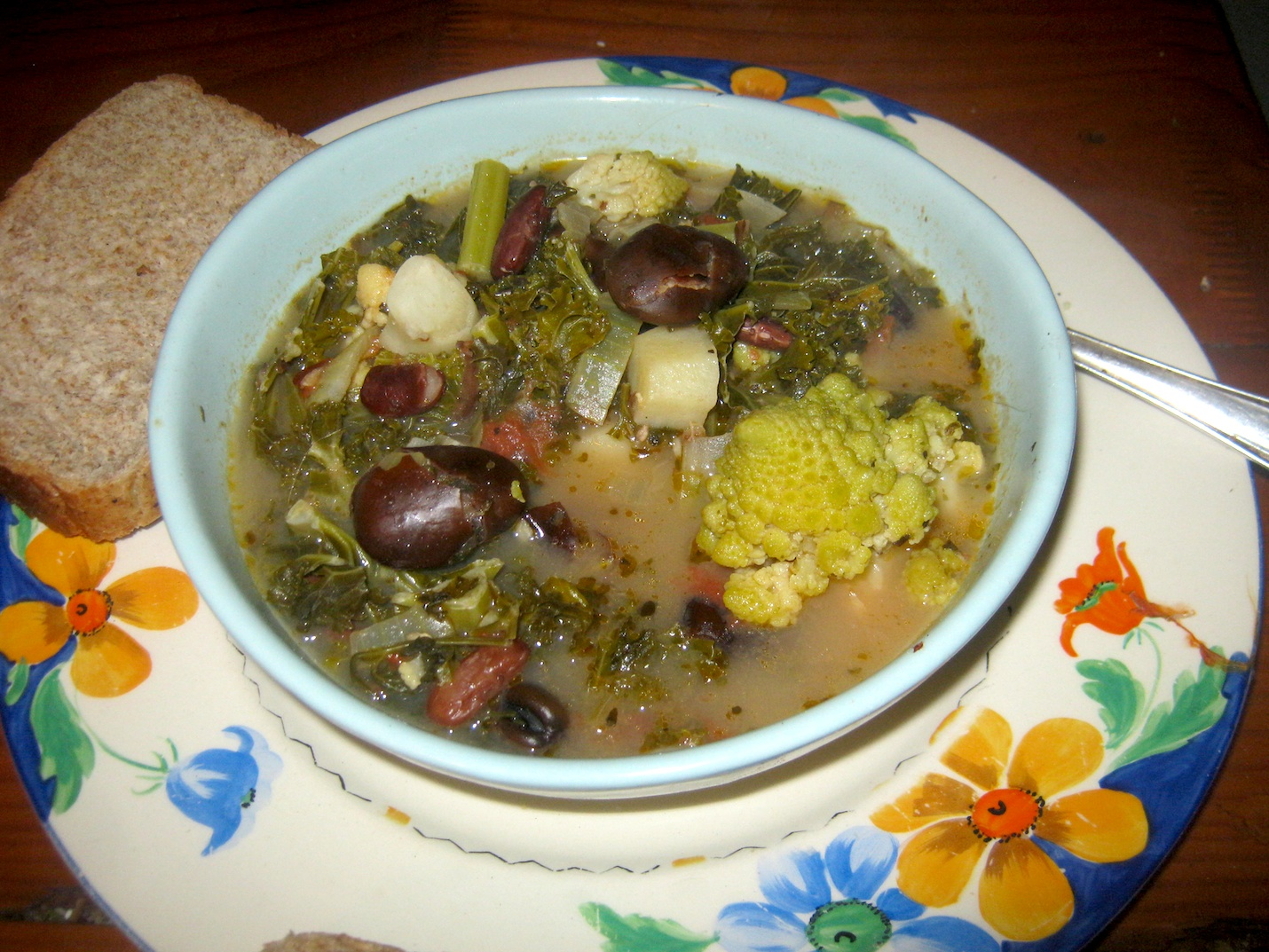Kale and bean soup served in a bowl