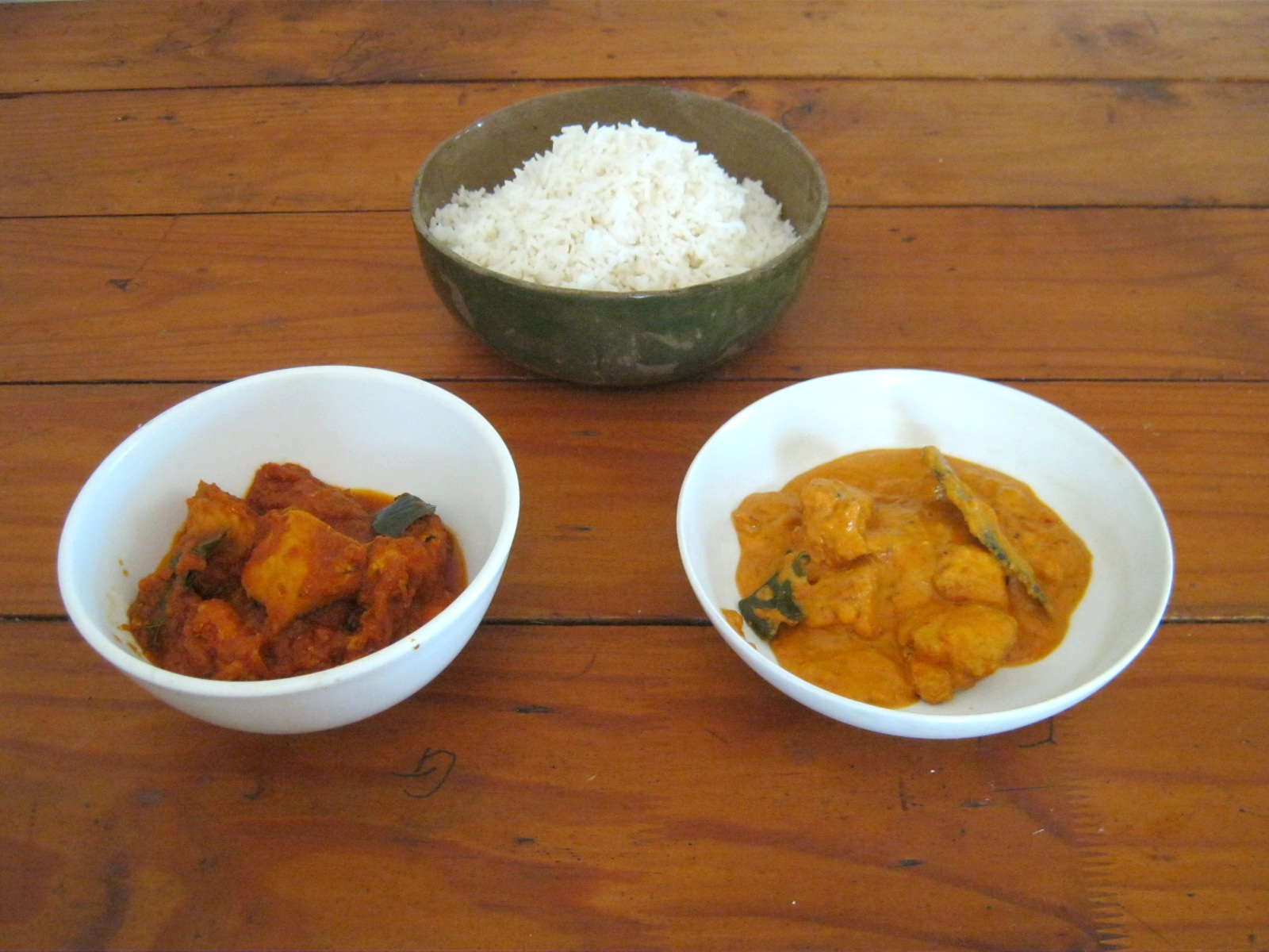 Madras chicken curry served in white bowls