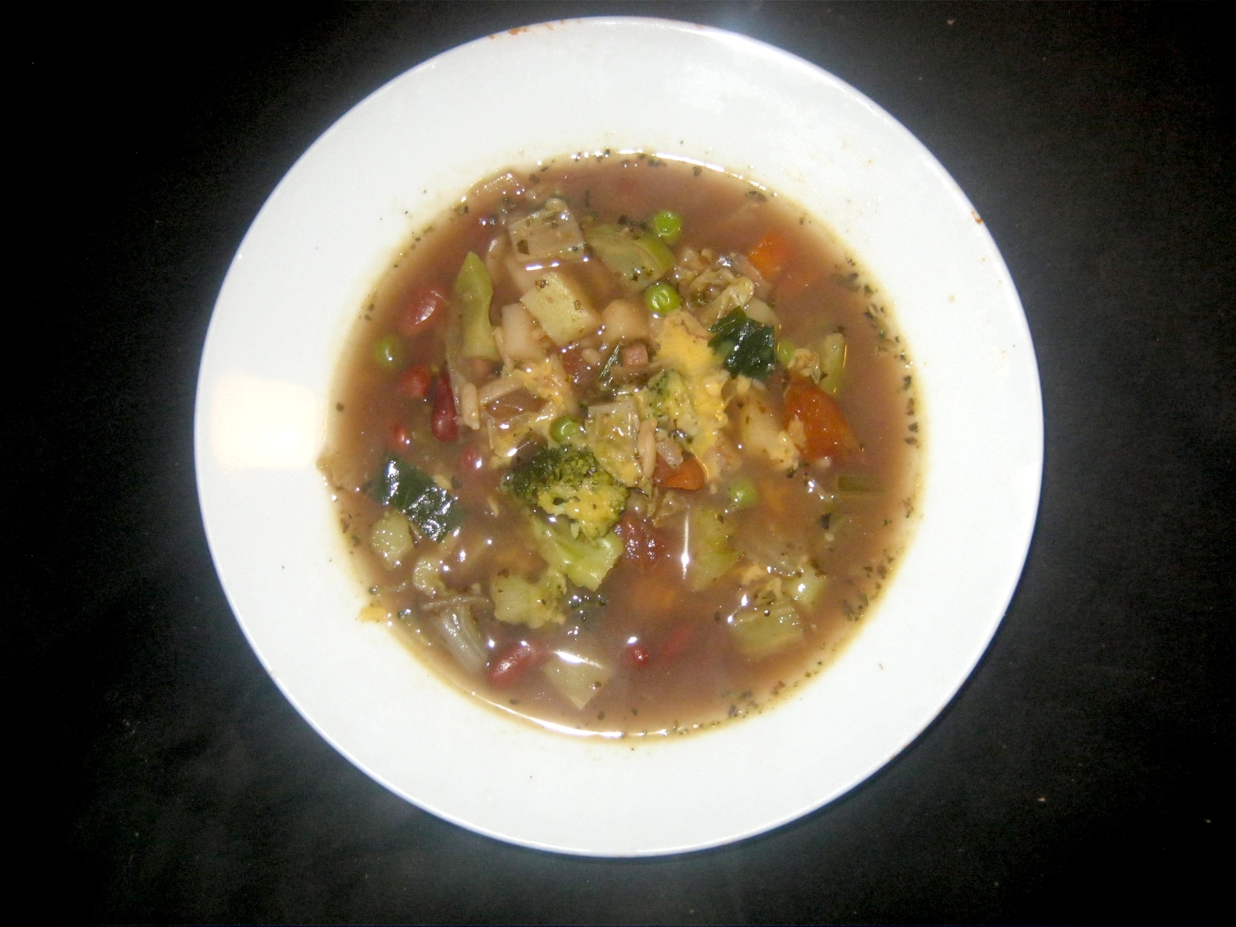 Minestrone served in white bowl