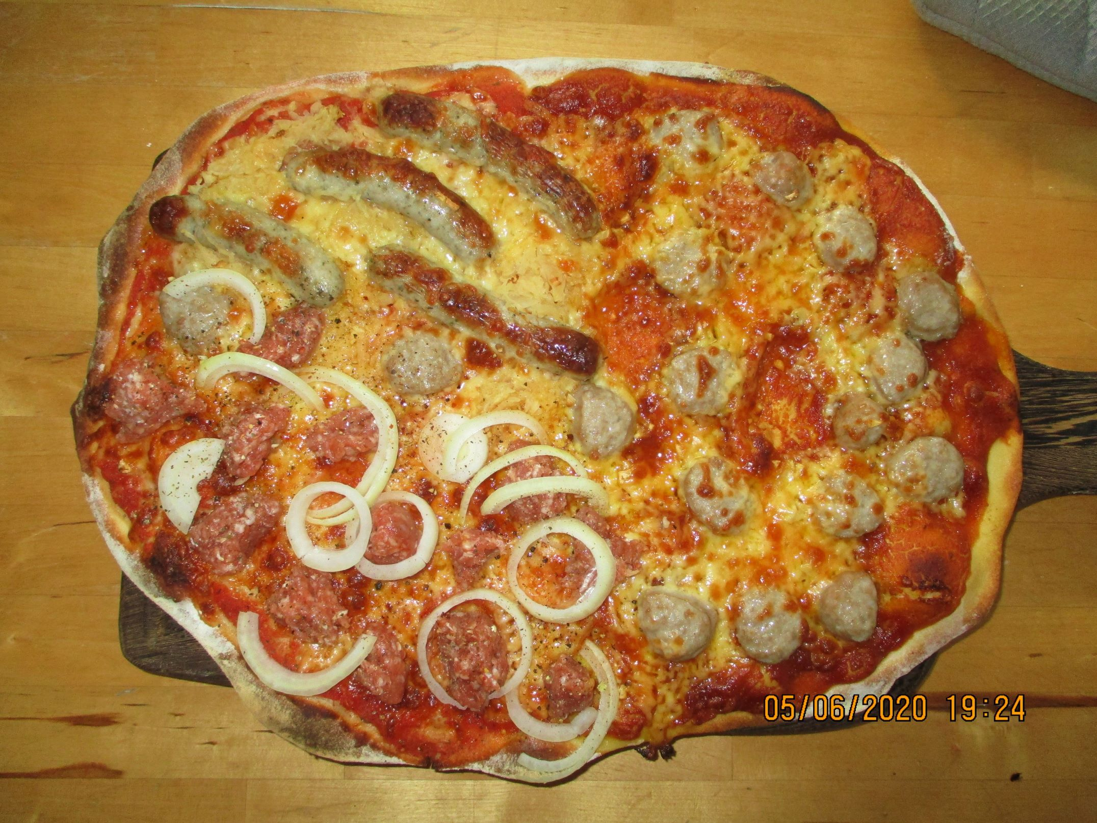 Pizza Germanica with Currywurst, Bratwurst, Sauerkraut and Mett.