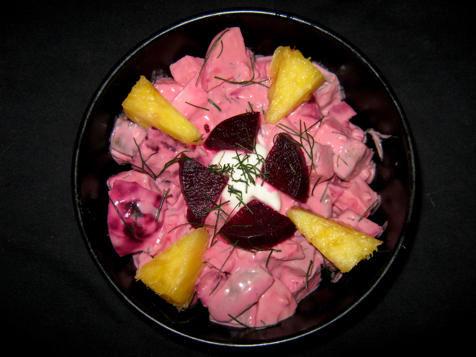 Red Herring salad with beetroot and pineapple in a bowl