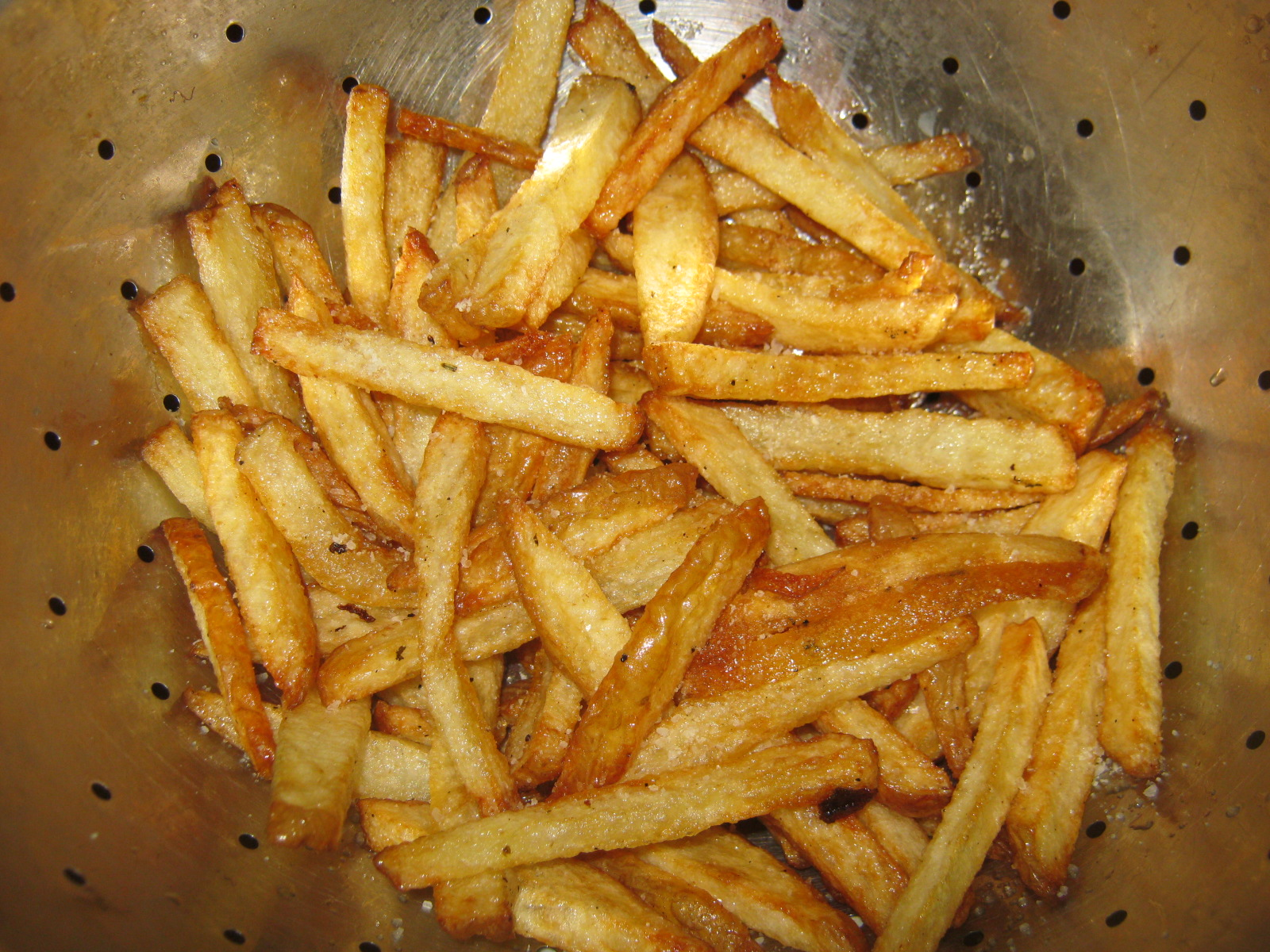 Quick and easy French fries in a colander.