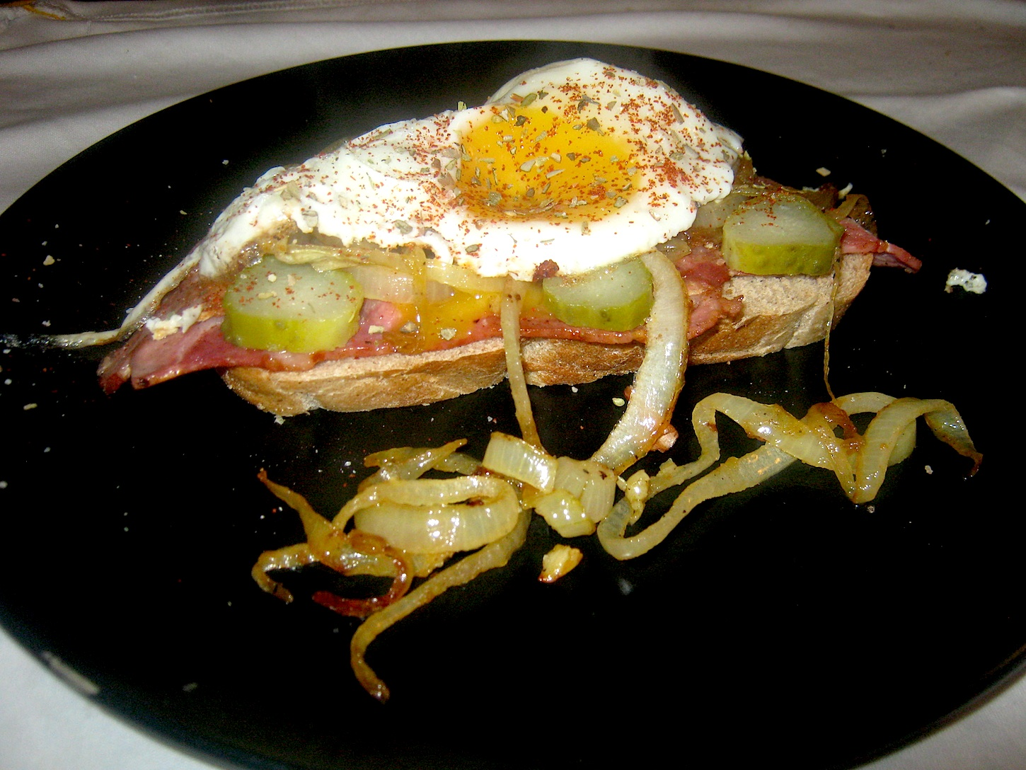 Strammer Max on 60% Rye bread with fryed onions, garlic, gherkins and sweet and sour mustard cucumbers