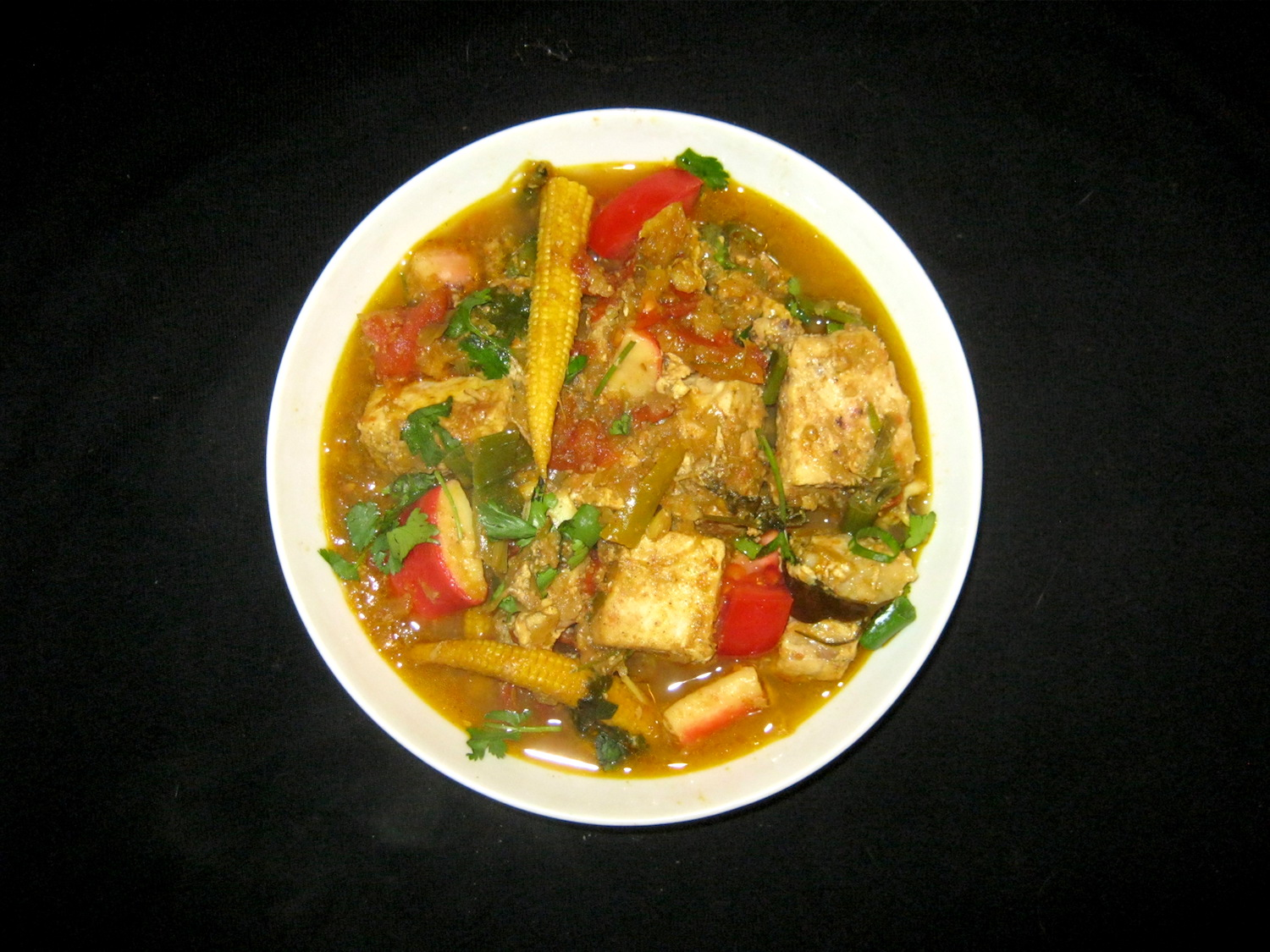 Green Swordfish Curry in a white bowl