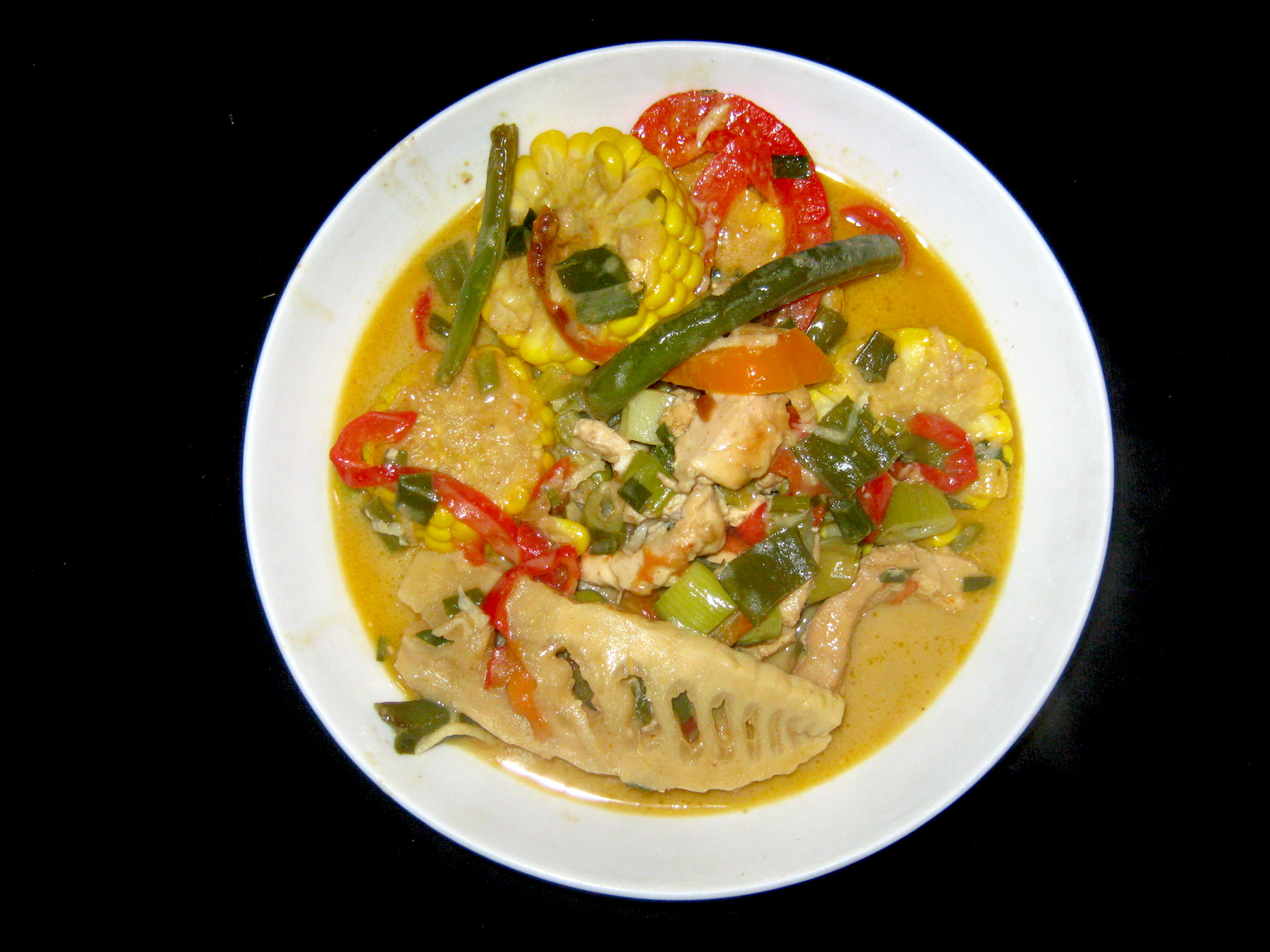 Thai yellow curry in a white bowl