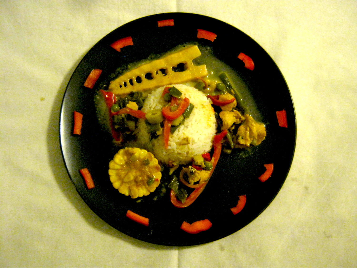 Thai Yellow Curry with peppers and bamboo shoots served on a black plate