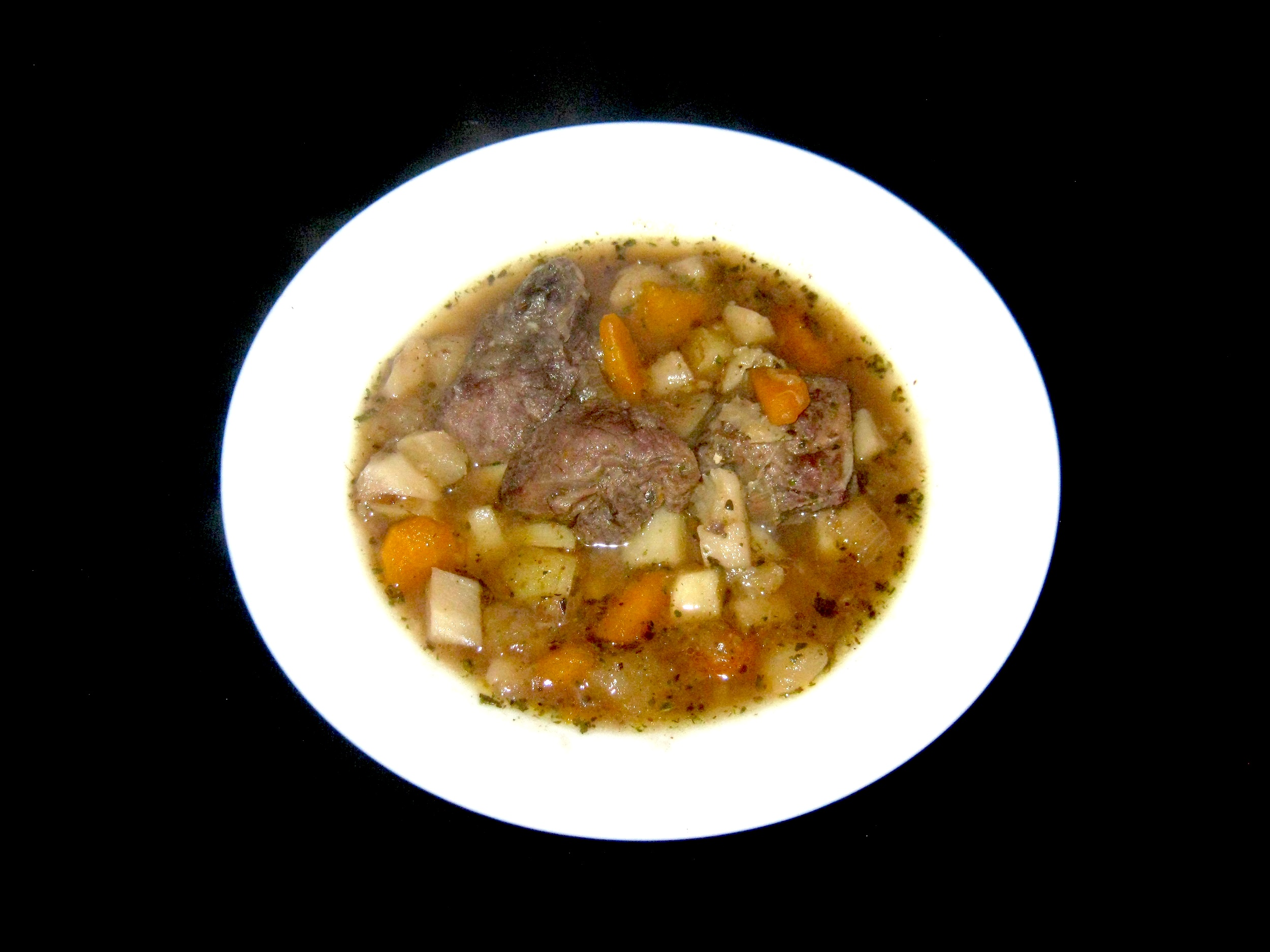 Turnip soup with venison served in a white bowl