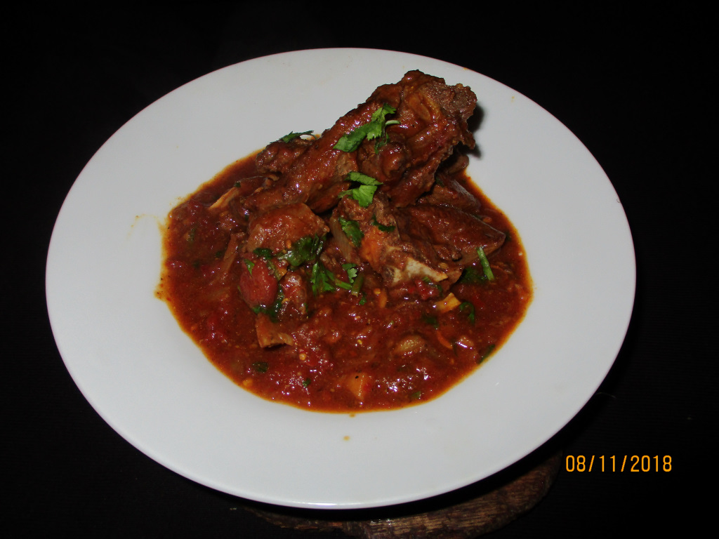 Venison Rogan Josh served on a white plate